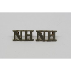 Pair of Northumberland Hussars (N.H.) Shoulder Titles