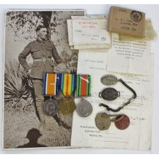 WW1 British War Medal, Victory Medal and WW2 Defence Medal with Dog Tags, Identity Bracelet and Boxes of Issue - Gnr. A.V. Bolam, Royal Artillery